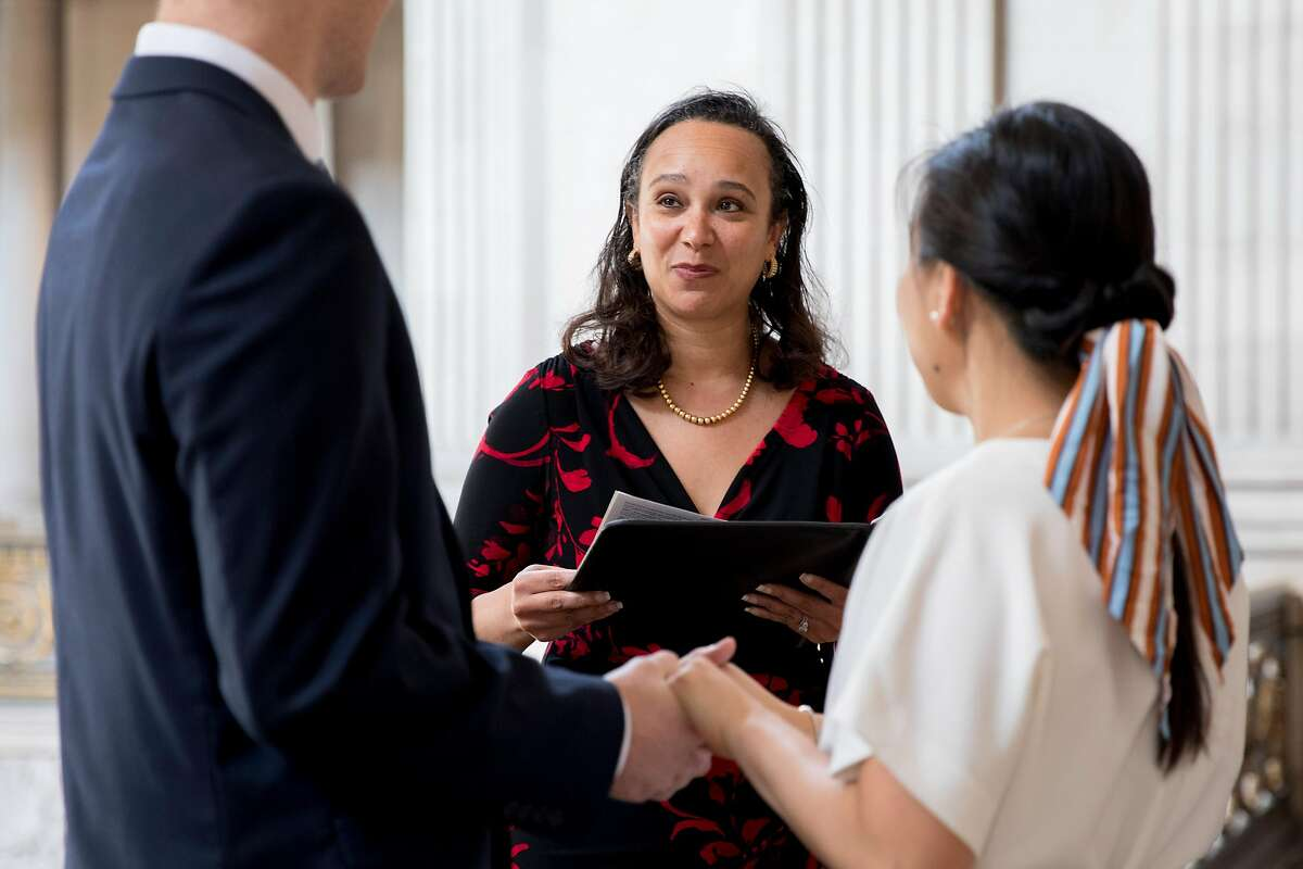San Francisco City Administrator Naomi Kelly, whose husband has been charged with accepting bribes, officiates a wedding in City Hall in 2020. Kelly notified Mayor London Breed that she would leave her post effective Feb. 1.