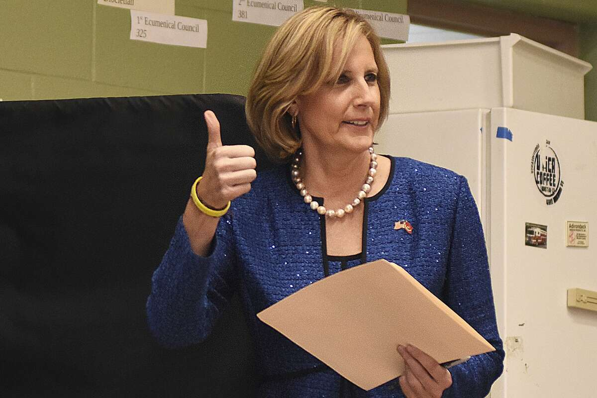 FILE - In this Nov. 6, 2018, file photo, Republican Congresswoman Claudia Tenney signals she successfully cast her ballot after voting at St. George's Church in New Hartford, N.Y. On Tuesday, Dec. 1, 2020, Chenango County informed a state judge it had discovered 55 early voting ballots that weren't canvassed by the local board of election, and therefore weren't included in the vote totals in the ultra-tight race between Tenney and U.S. Rep. Anthony Brindisi. The most recent results �