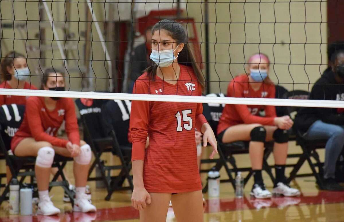 Masuk's Ana Castro-Rodriguez (15) stays focused as she gets ready for a point in a volleyball match during the 2020 season.
