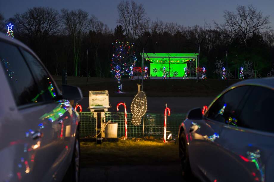 Dozens of vehicles gather for the first night of the annual Freeland Light Show Tuesday, Dec. 1, 2020 at Tittabawassee Township Park in Freeland. The show starts daily at 5:30 p.m., with the last show starting at 10 p.m.. Each show lasts around 12 minutes, with a 3-minute break between shows. No admission is required; however, 100% of all donations will benefit the Great Lakes Bay Region Child Abuse and Neglect (CAN) Council and Saginaw-Shiawassee Habitat for Humanity. (Katy Kildee/kkildee@mdn.net) Photo: (Katy Kildee/kkildee@mdn.net)