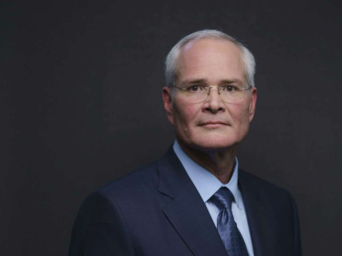 Darren Woods, chief executive of Exxon Mobil. Exxon has made deep cuts as it tries to protect its dividend.