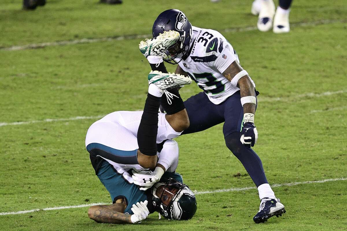 PHILADELPHIA, PENNSYLVANIA - NOVEMBER 30: Travis Fulgham #13 of the Philadelphia Eagles rolls on his head after making a catch against Jamal Adams #33 of the Seattle Seahawks during the fourth quarter at Lincoln Financial Field on November 30, 2020 in Philadelphia, Pennsylvania. (Photo by Elsa/Getty Images)