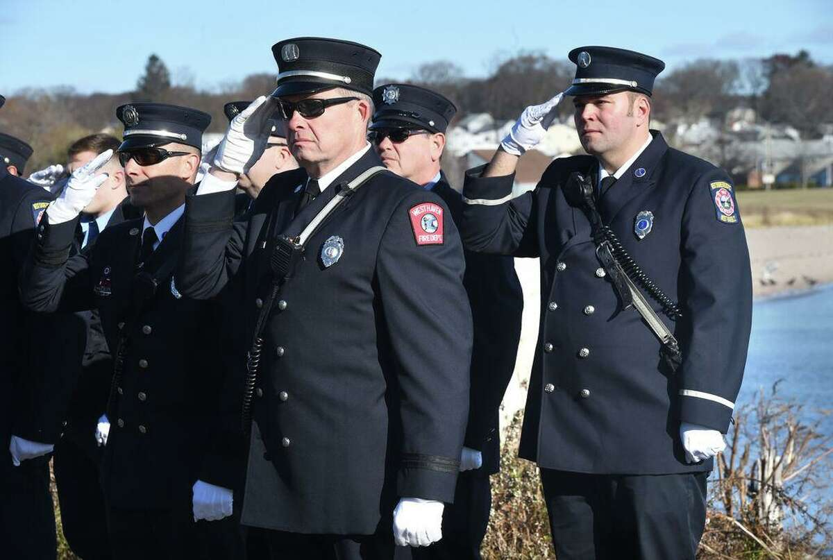 In this file photo, the West Haven Fire Department Honor Guard salute during a ceremony for the 77th anniversary of the Japanese bombing of Pearl Harbor at Bradley Point Park in West Haven on Dec. 7, 2018.