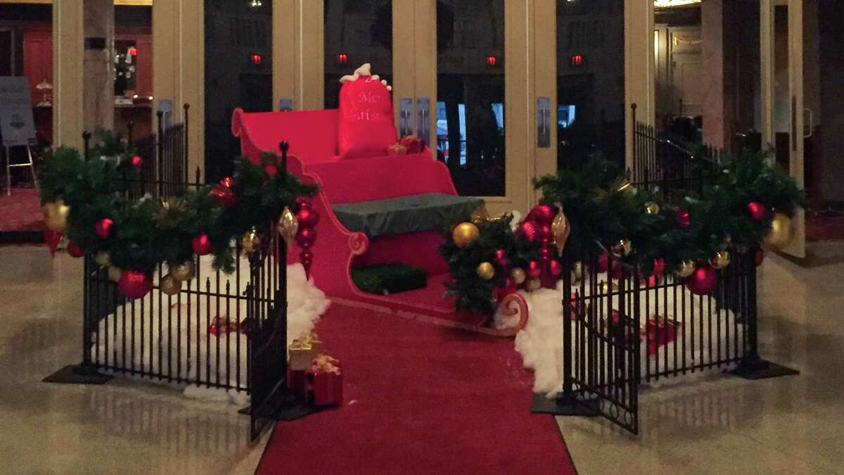 Families can take their holiday photo in the lobby of the Palace Theater, which is dressed up for the occasion.