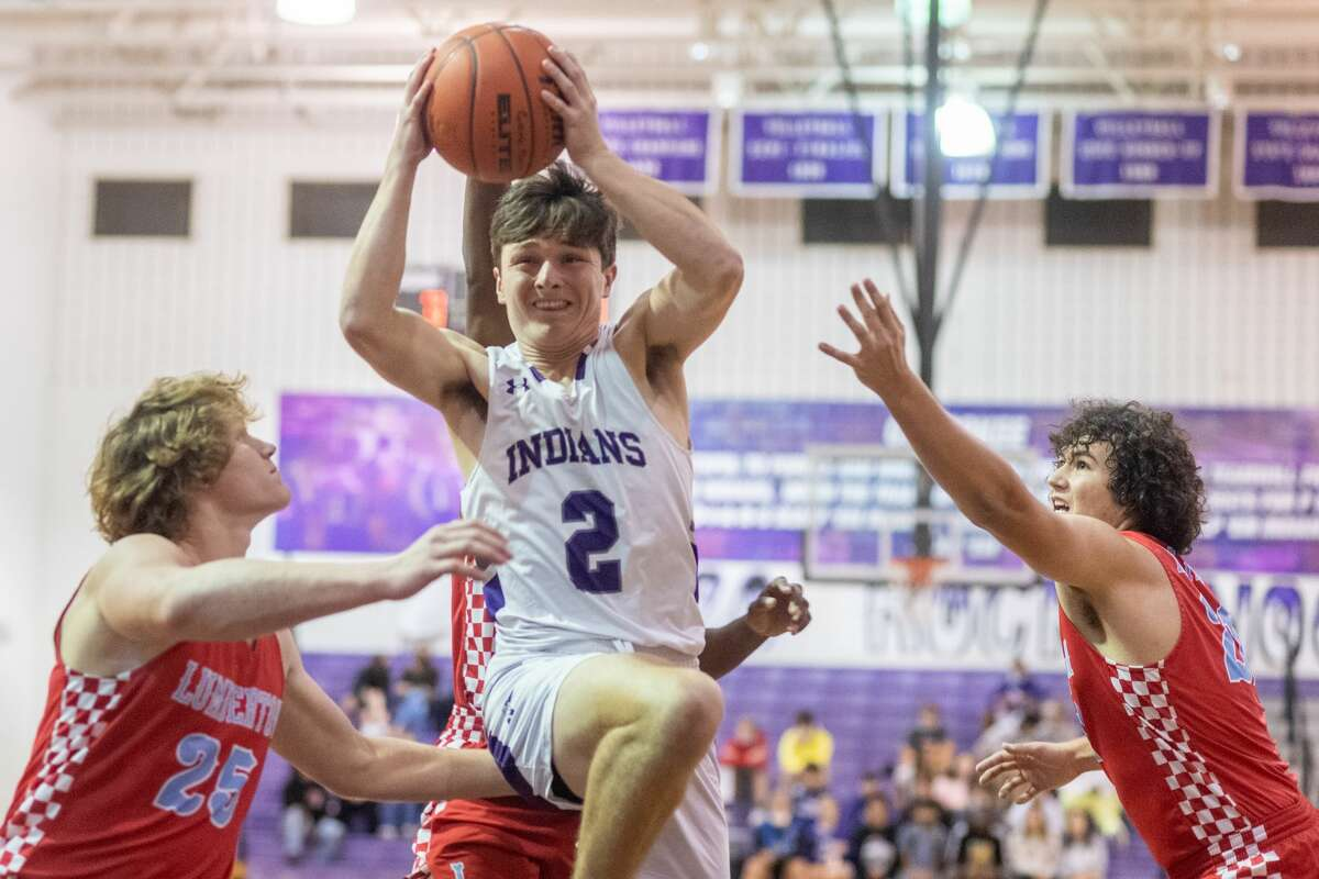 Indians Brady Nail (2) tries to put up a shot between Raiders Trevor Hataway (25) and Josh Landry (21) in the first quarter. The Lumberton Raiders traveled to Port Neches-Groves High School to take on the Indians in hoop action Tuesday evening. Photo made on December 1, 2020. Fran Ruchalski/The Enterprise