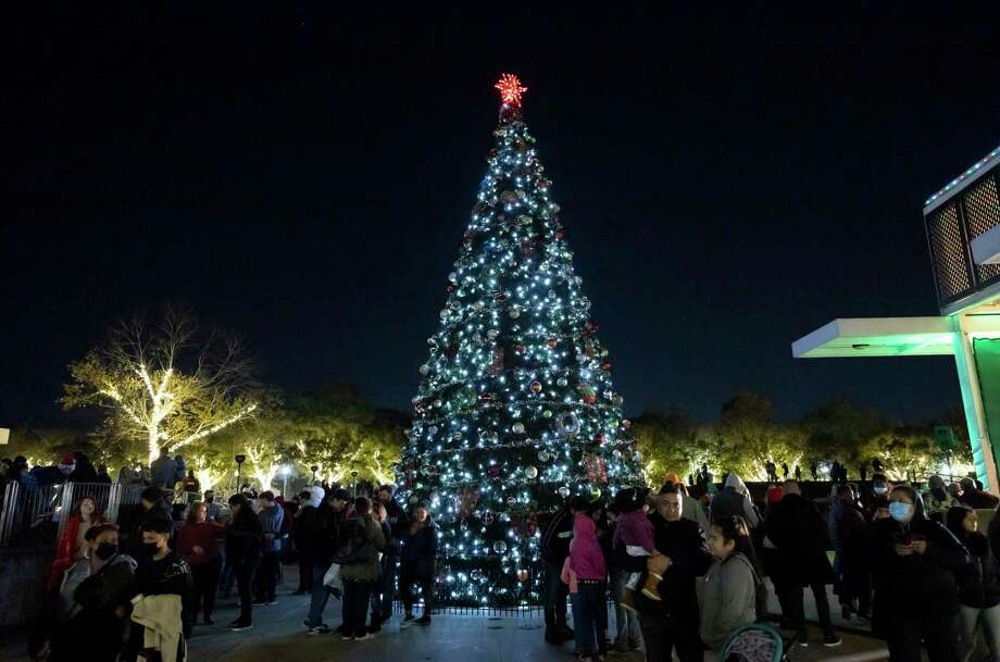 Spectators gather around a Christmas tree during the Conroe Christmas Tree Lighting event in Heritage Park, Tuesday, Dec. 1, 2020, in Conroe. Hundreds of people converged to partake in the festivities. Photo: Gustavo Huerta, Houston Chronicle / Staff Photographer / 2020 © Houston Chronicle