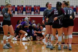 Magnolia players react after losing to Fulshear in five sets during a Region III-5A semifinal high school volleyball playoff match at Cypress Springs High School, Tuesday, Dec. 1, 2020, in Cypress.