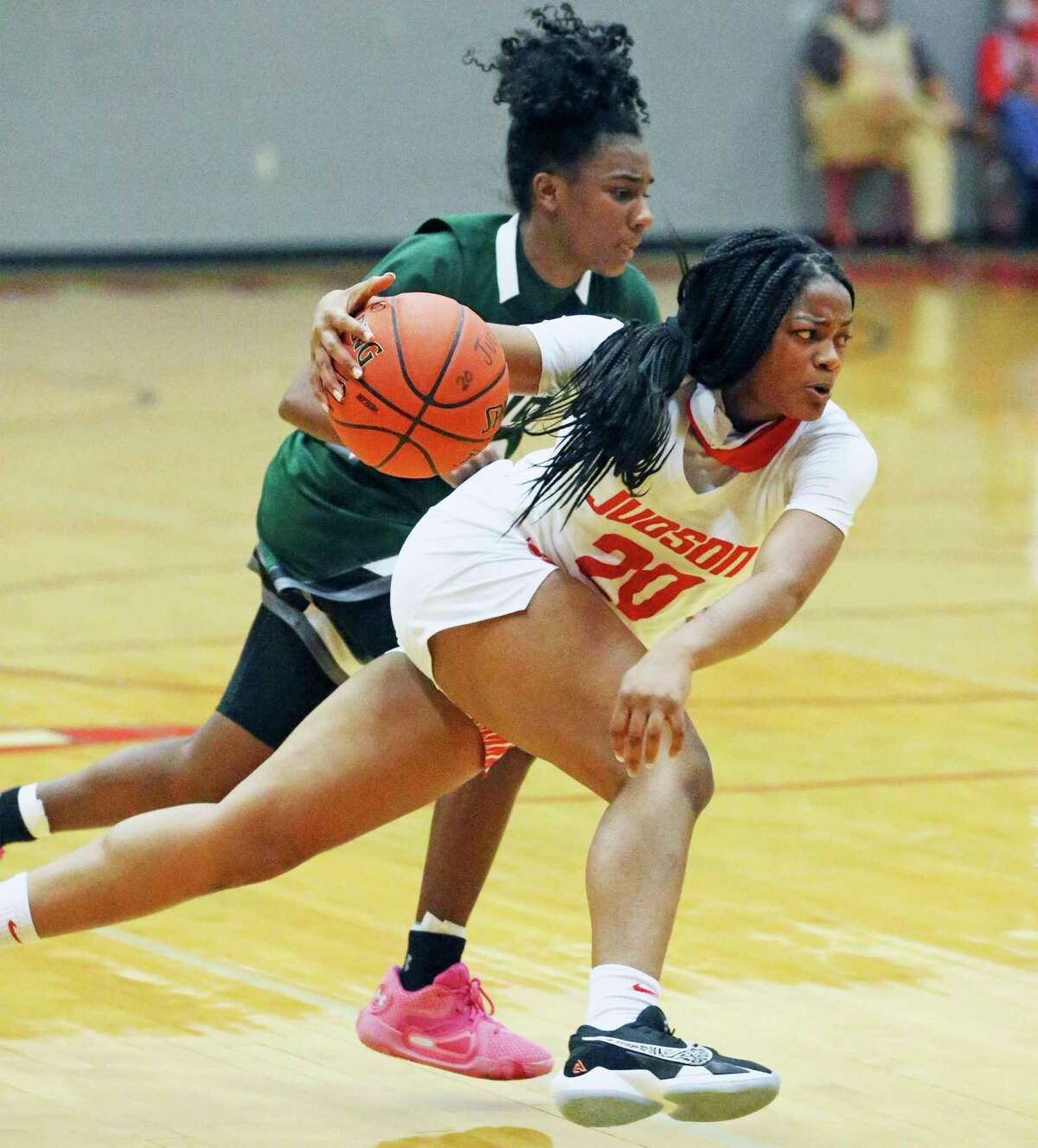 Rocket guard Kierra Sanderlin takes a long step into the lane as Judson hosts Reagan in girls basketball at Judson gym Dec. 1, 2020.