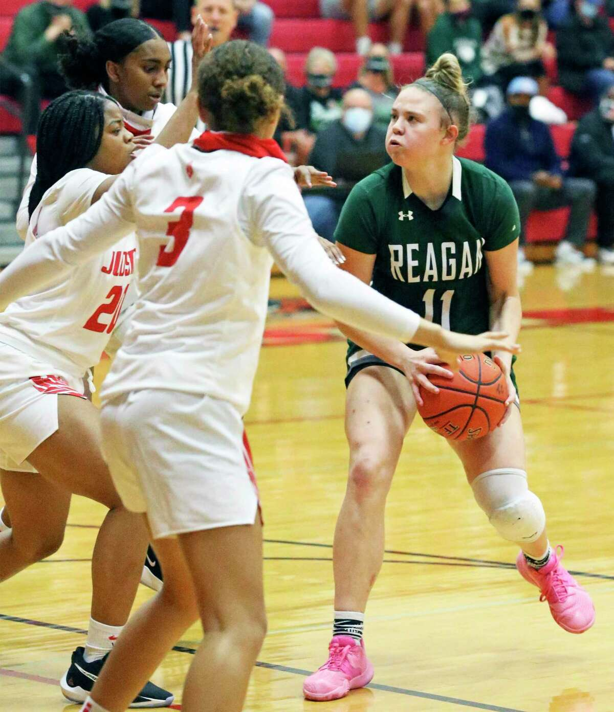 Rattler forward Samantha Wagner draws a triple team as she moves into the key for a jumper as Judson hosts Reagan in girls basketball at Judson gym Dec. 1, 2020.