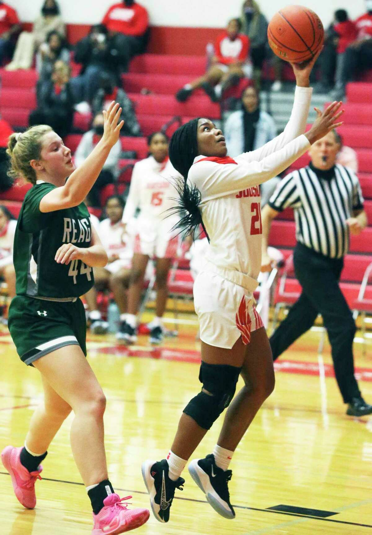 Rocket guard Kierstein Sanderlin gets in front of Miranda Noack for a layup as Judson hosts Reagan in girls basketball at Judson gym Dec. 1, 2020.