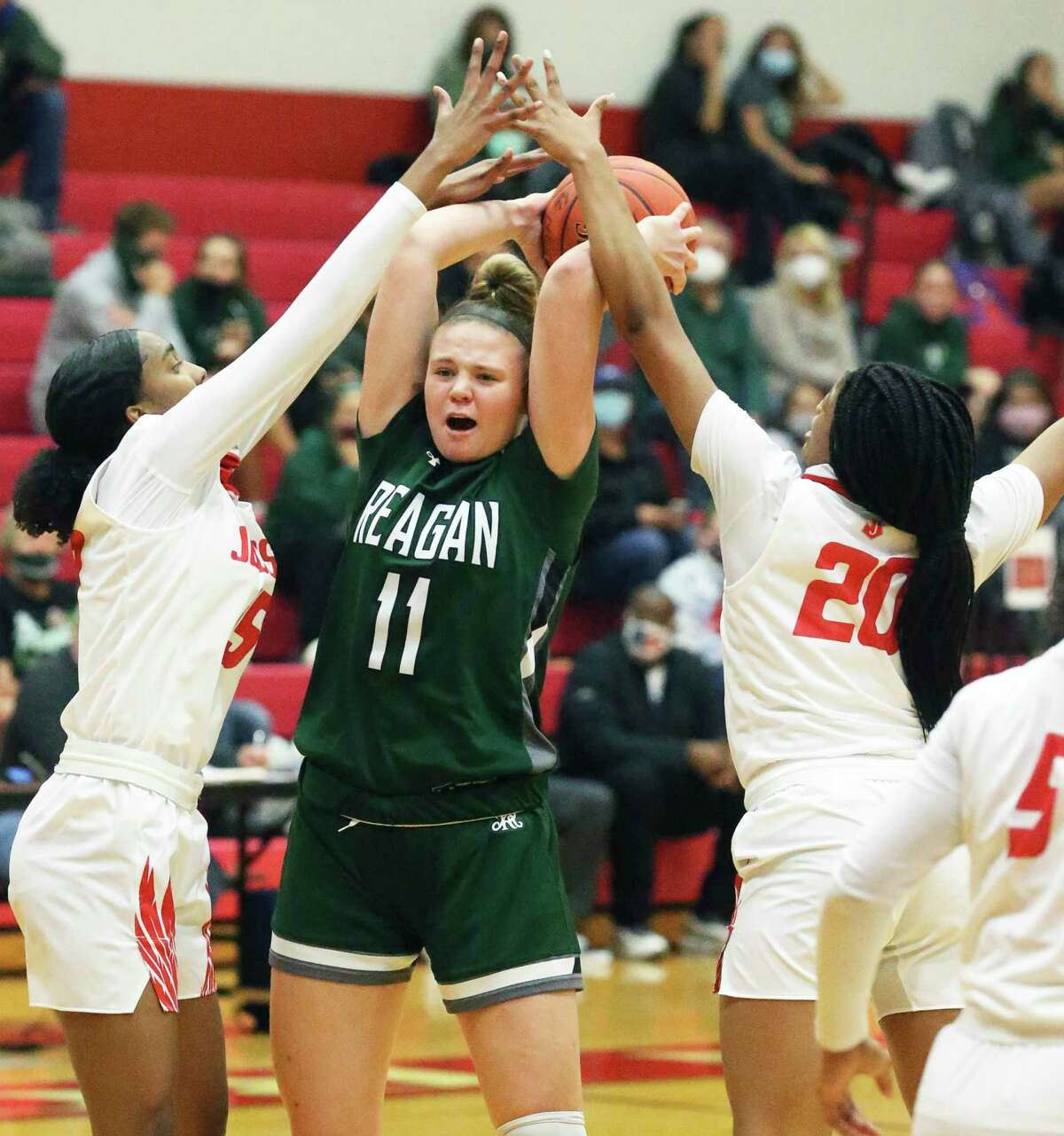 Rattler ball handler Samantha Wagner gets pressured by a double team when she pulls up the dribble as Judson hosts Reagan in girls basketball at Judson gym Dec. 1, 2020.