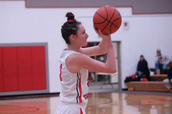 Ellen Bretzke takes a shot during a Feb. 24 game against North Bay last winter. (File photo)