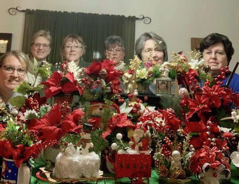 As a way to bring cheer and brightness to homebound and nursing home residents, five members of GFWC Big Rapids along with a guest prepared floral arrangements. Utilizing recycled cups, vases, bottles and flowers, they prepared 17 Thanksgiving arrangements and 40 Christmas arrangements. The Thanksgiving arrangements were delivered to individuals at their homes and the Christmas arrangements will be delivered to three local nursing homes giving time for them to set in quarantine prior to being given to the residents. This is GFWC's way of recycling items into something beautiful to brighten someone's day. Pictured from left is: Guest Christa Eling and GFWC members Carrie Franklund, President Ann Stellard, Joyce Iltis, Sue Johnson and Linda Telfer. (Courtesy photo)
