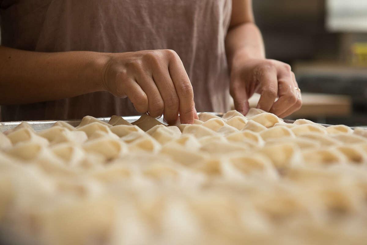 Cathay Bi prepares Berkshire pork wontons for Dumpling Club, a weekly sale of frozen dumplings and side dishes.