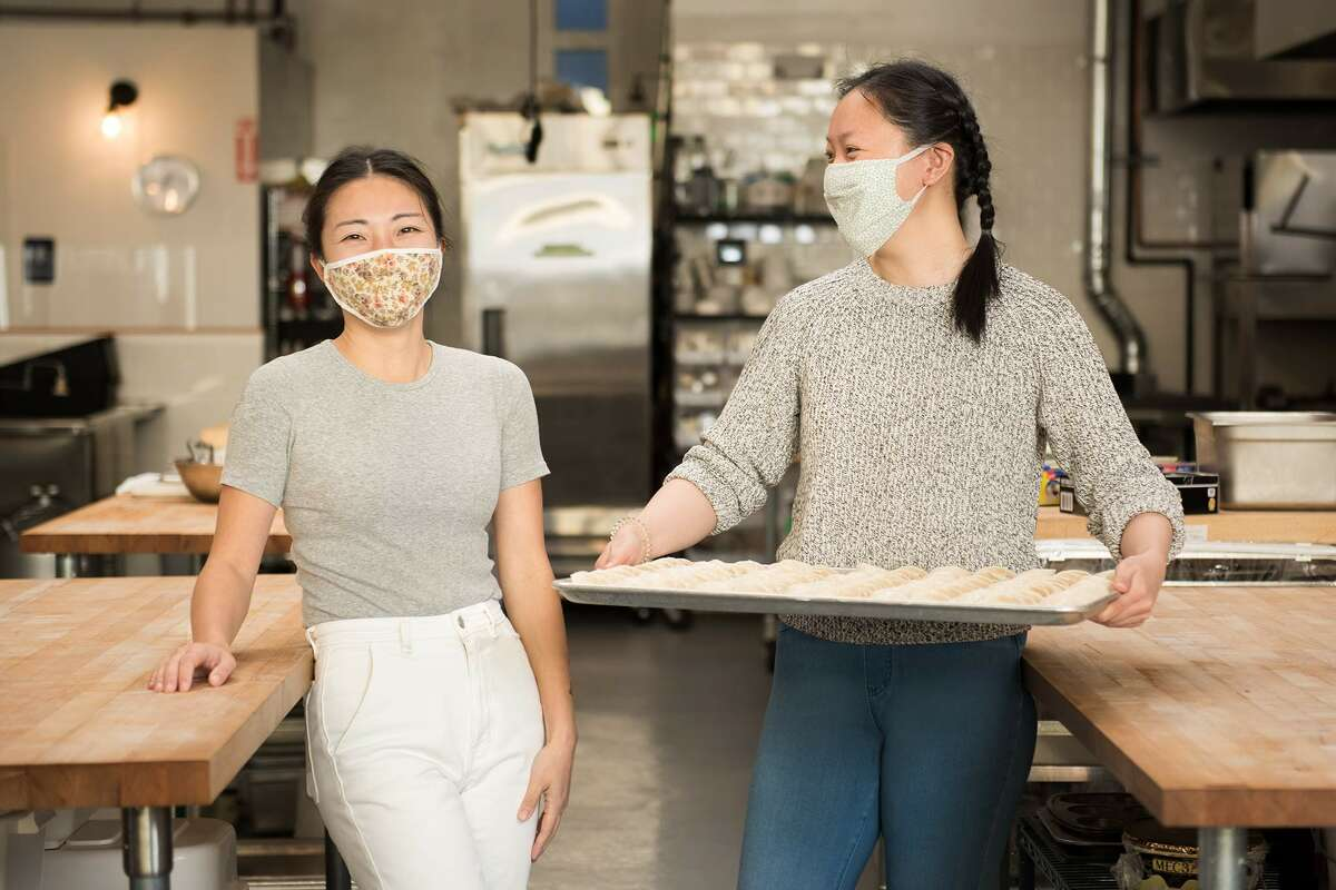 Cathay Bi, founder of Dumpling Club (left) and and prep cook Linda Mei (right).
