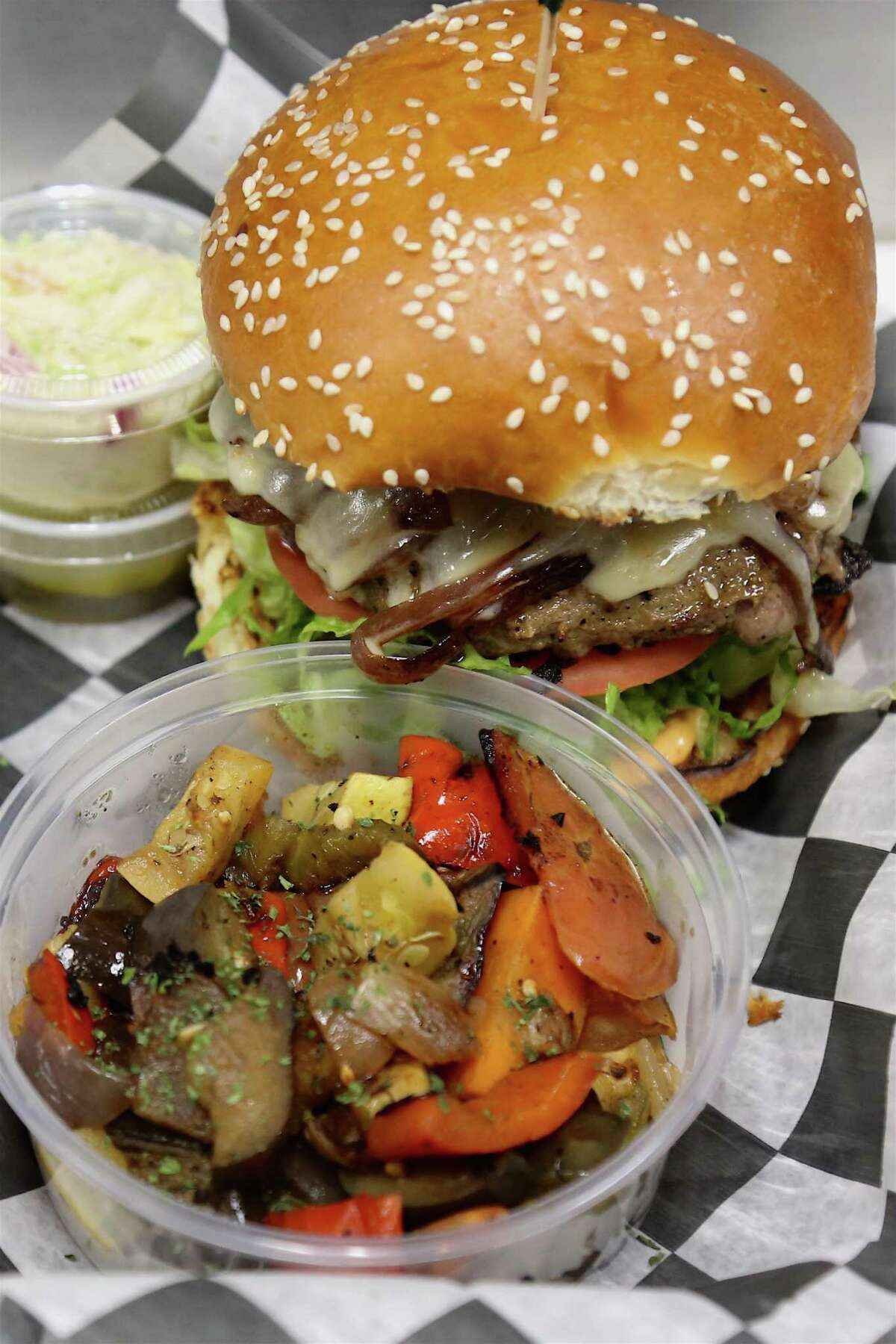 A burger with a side of vegetables at Burger Boss on Main Avenue in Norwalk.