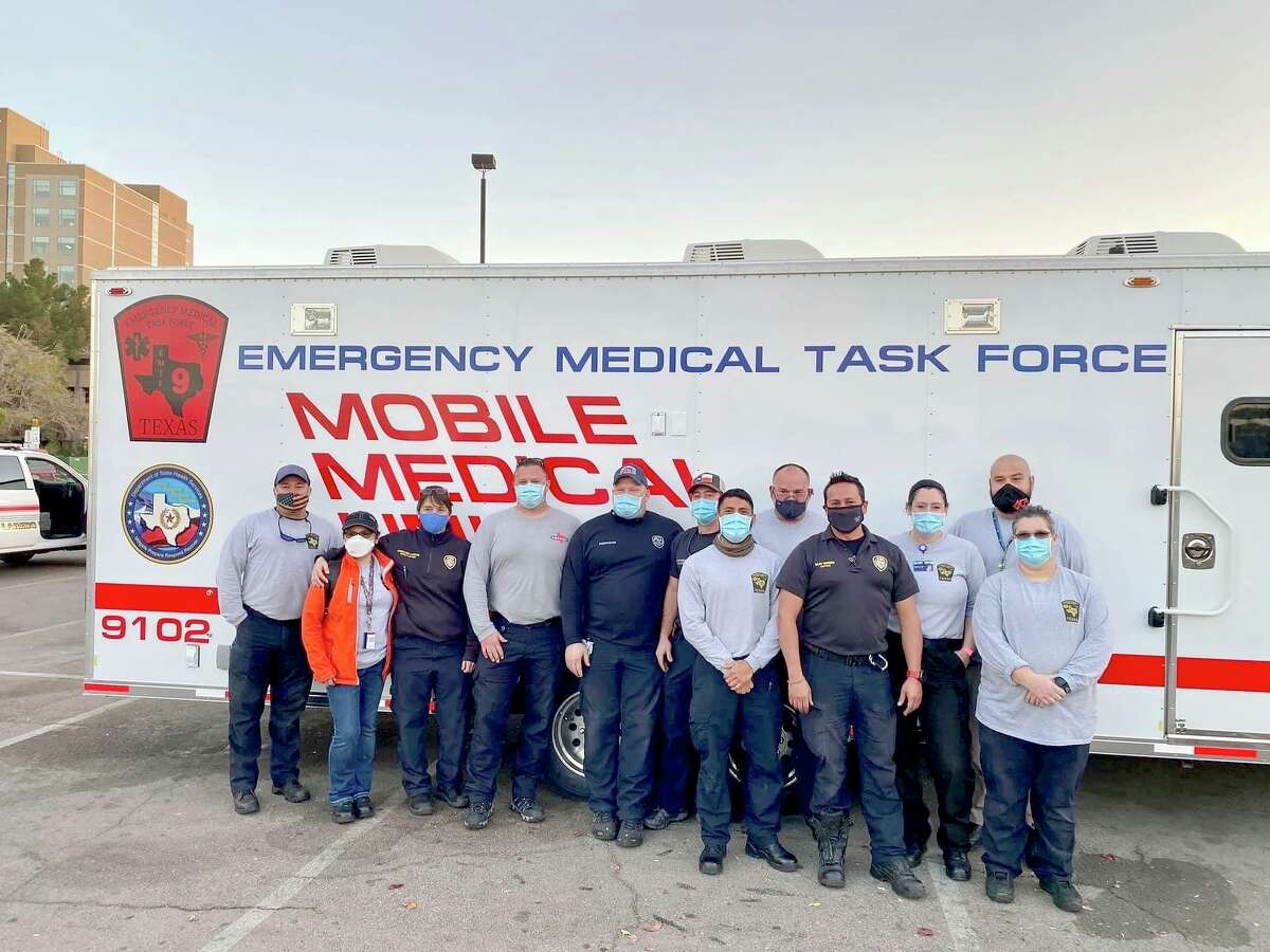 Houston Fire Department members and other personnel pose by a mobile medical unit van in El Paso where they worked to help tackle the coronavirus crisis from Oct. 23 to Sunday.