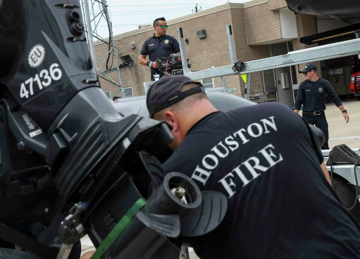 Captain Beau Moreno, center, and firefighters from Houston Fire Station 11 prepare water-rescue equipment Monday, Aug. 24, 2020, at HFD Station 11 in Houston. Tropical weather systems are expected to hit Texas and Louisiana later in the week.