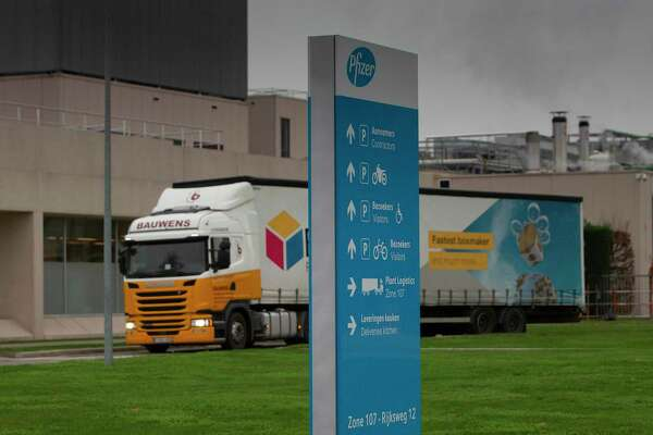 A truck leaves Pfizer Manufacturing in Puurs, Belgium, on Wednesday, Dec. 2, 2020. British officials authorized a COVID-19 vaccine for emergency use on Wednesday, greenlighting the world's first shot against the virus that's backed by rigorous science and taking a major step toward eventually ending the pandemic. (AP Photo/Virginia Mayo)