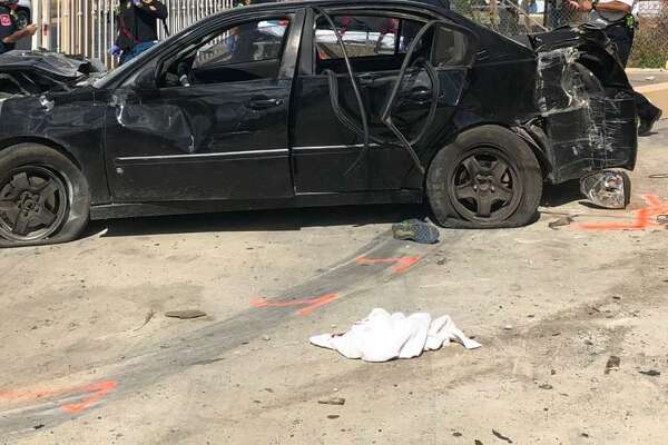 This black Chevy Malibu crashed at a local business following a pursuit with authorities. One immigrant who was riding in the trunk would later die at Laredo Medical Center.