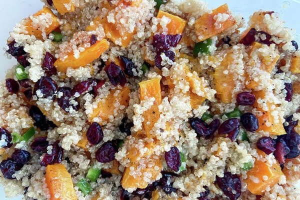 The dish features roasted butternut squash, quinoa and cranberries with a homemade vinaigrette dressing.