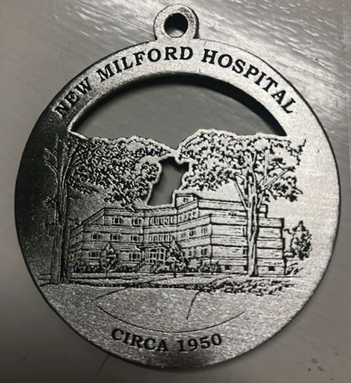The New Milford Historical Society & Museum is offering its 2020 commemorative medallion for holiday purchase. This year's medallion features images of New Milford Hospital both as it appeared in mid-20th century from Elm Street and its contemporary look.