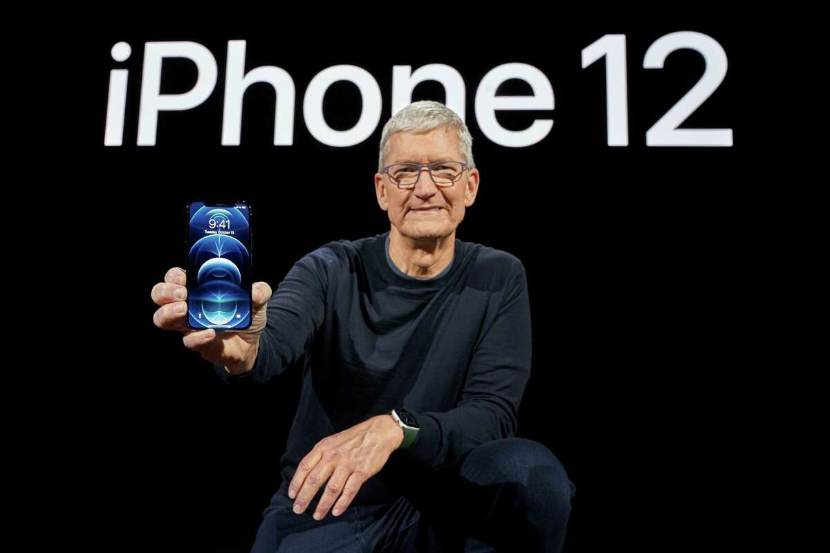 In this photo released by Apple, Apple CEO Tim Cook holds up the all-new iPhone 12 Pro during an Apple event at Apple Park in Cupertino, California on October 13, 2020. Apple ranked No. 4 in global smartphone sales in the third quarter of 2020, with about 41 million units sold, according to Gartner.