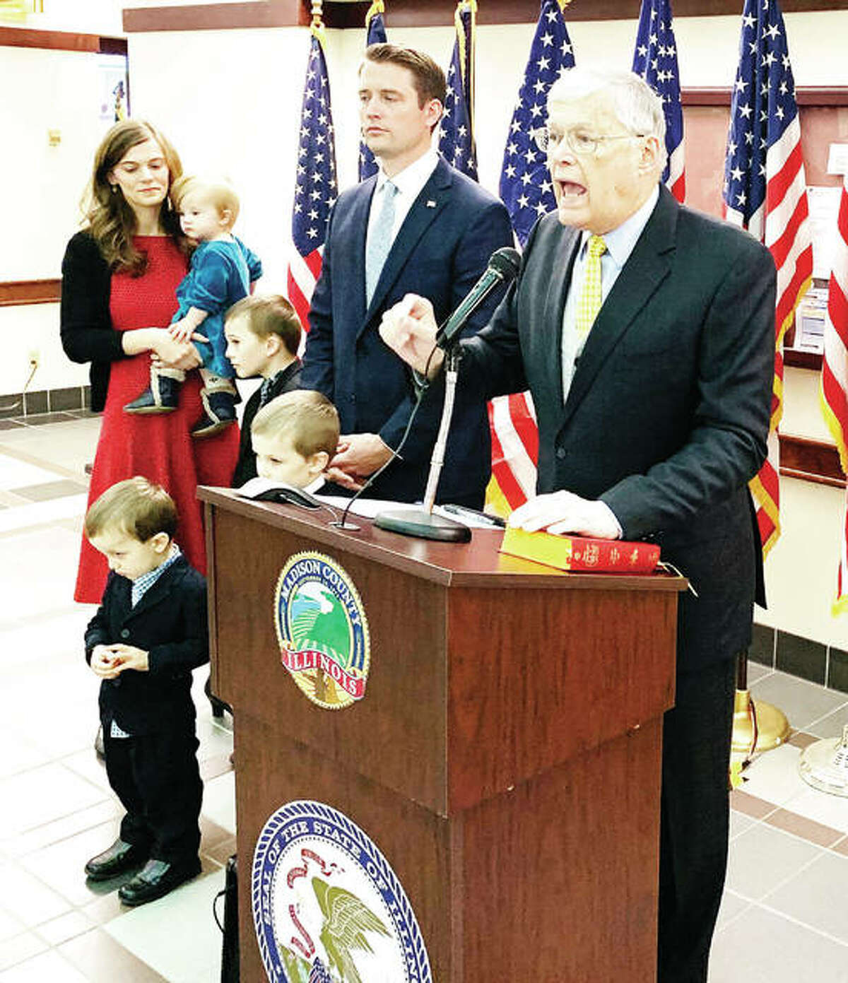 Former Madison County State's Attorney and Illinois State Senator Bill Haine speaks before swearing in his son, Thomas Haine, as the new Madison County State's Attorney during a ceremony Tuesday at the Madison County Administration Building. Because of COVID, the swearing in of several officials was spread out to every half hour.