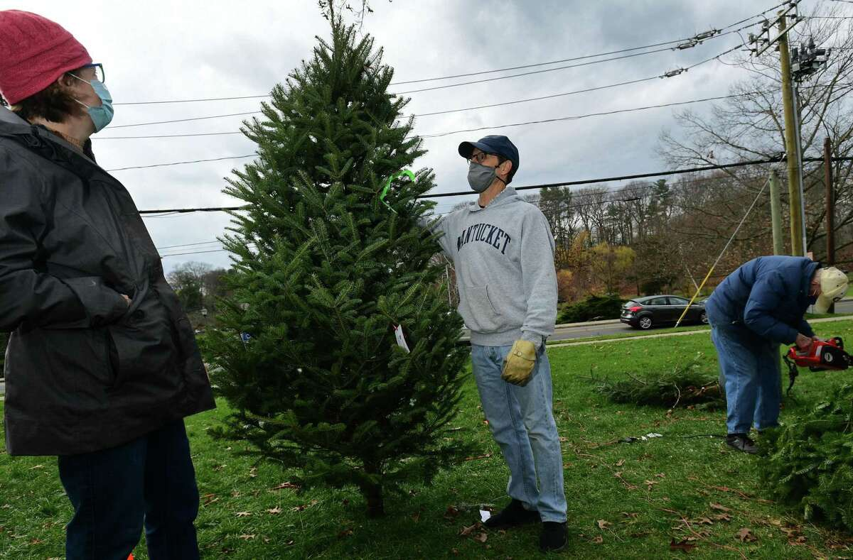 Local residents including Alison Cox and her husband Rick Grellier shop at The First Congregational Church of Greenwich Annual Tree & Wreath Sale Saturday, November 28, 2020, in Greenwich, Conn. The sale runs weekends beginning Saturday through Sunday, December 6 while supplies last. The sale features 500 fresh cut Fraser and Balsam fir trees from New Hampshire and more than 200 balsam wreaths and roping. All proceeds will benefit local charities including Kids in Crisis, Children's Learning Center, Inspirica, Mothers for Others, Pacific House (young adult program), and First Church Fund to Benefit New Covenant Center Soup Kitchen.