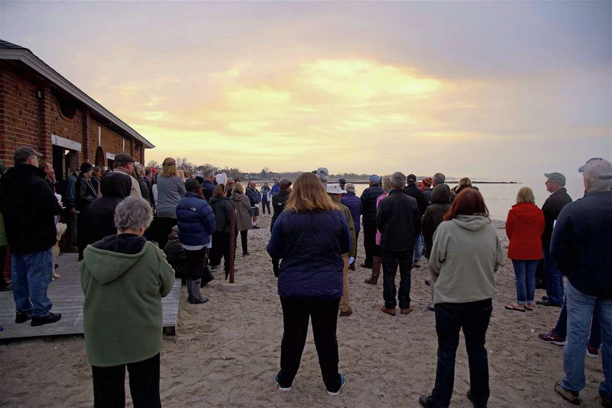 Worshipers watch the Easter morning sun rise last year on the beach at Long Island Sound.