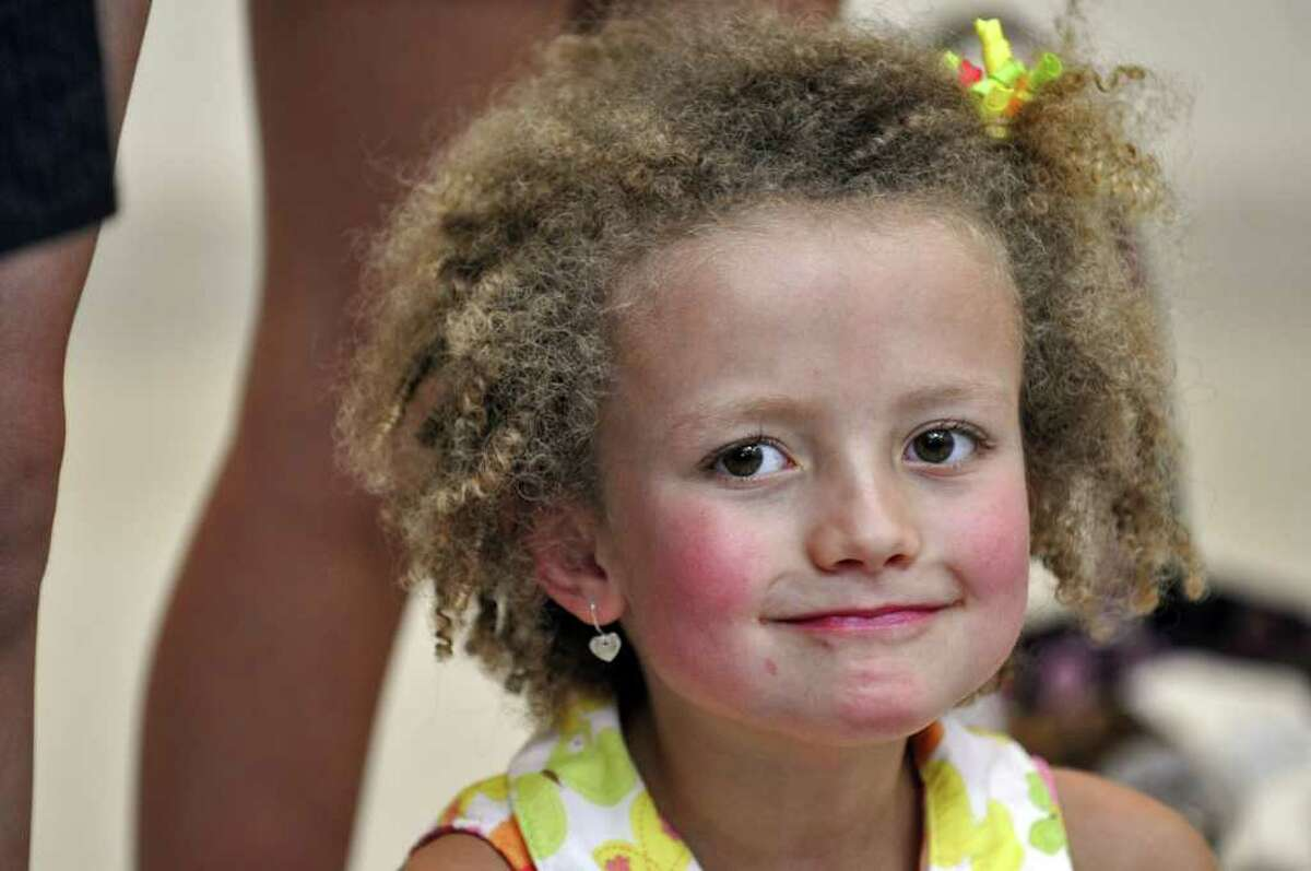 """Hannah Sames, 6, listens during a ceremony to thank the UAlbany community for their role in helping """"Hannah's Hope"""" to win a $250, 000 Pepsi Refresh Grant. ( Philip Kamrass / Times Union )"""