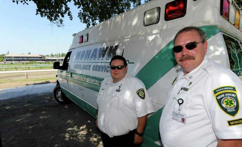 Ed Marchand, right, paramedic and supervisor for Mohawk Ambulance, and EMT Sal Vinviguerra drive the ambulance at the Saratoga Race Course in Saratoga Springs.   (Skip Dickstein/Times Union) Photo: Skip Dickstein / 2008