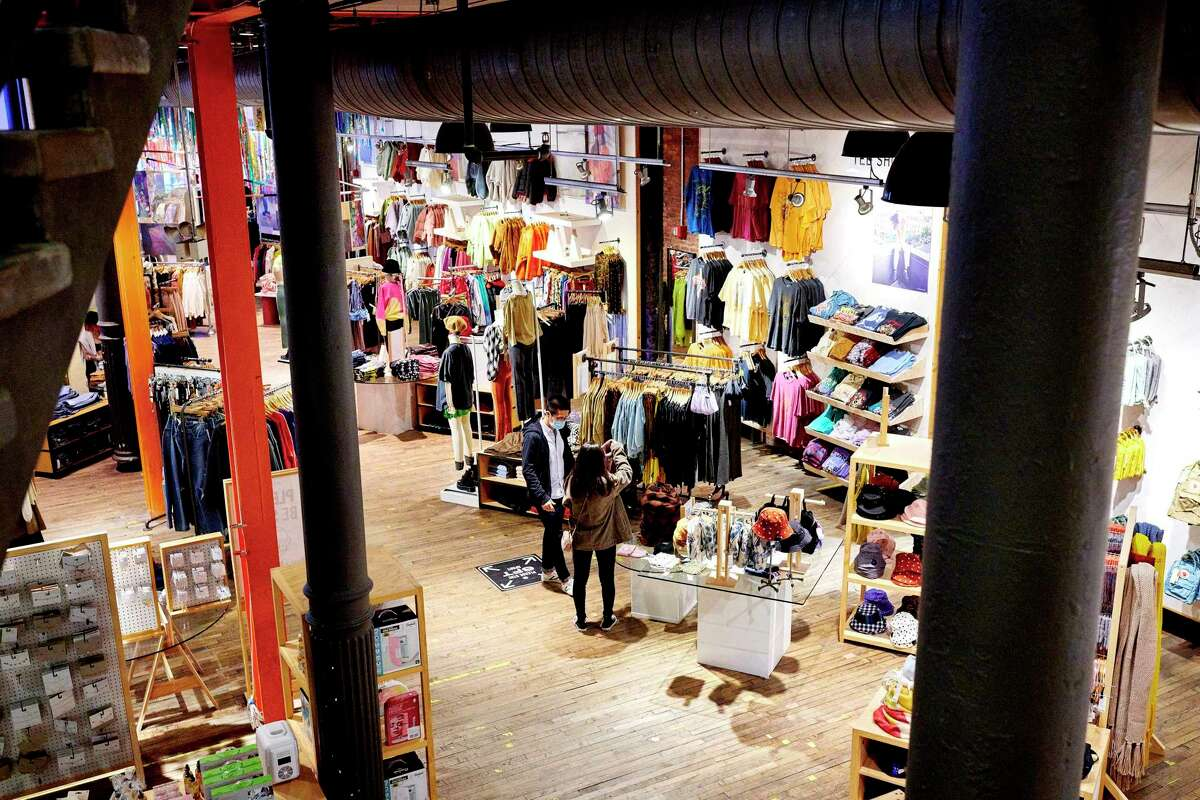 Shoppers at an Urban Outfitters in New York, on Black Friday, Nov. 27, 2020. Foot traffic was down considerably and internet sales surged during a holiday weekend altered by the coronavirus. (Gabby Jones/The New York Times)