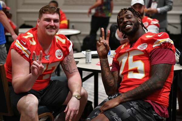 Kansas City Chiefs' Andrew Wylie (left) poses with teammate Cameron Erving during media availability for Super Bowl LIV on Jan. 30, 2020 in Aventura, Fla.