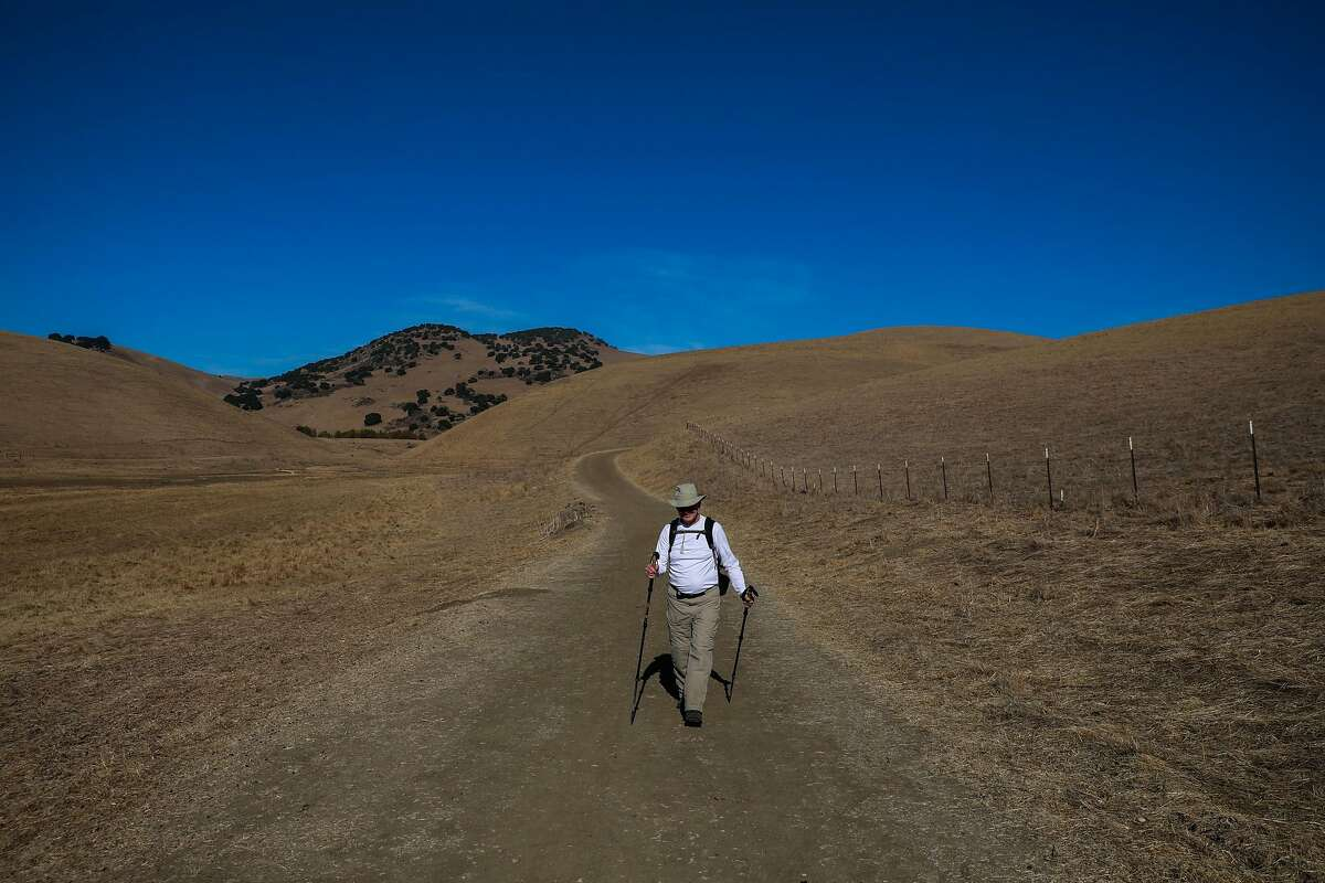 Mark Kluver hikes on a trail in Brushy Peak Regional Preserve on Monday, Nov. 16, 2020 in Livermore, California.