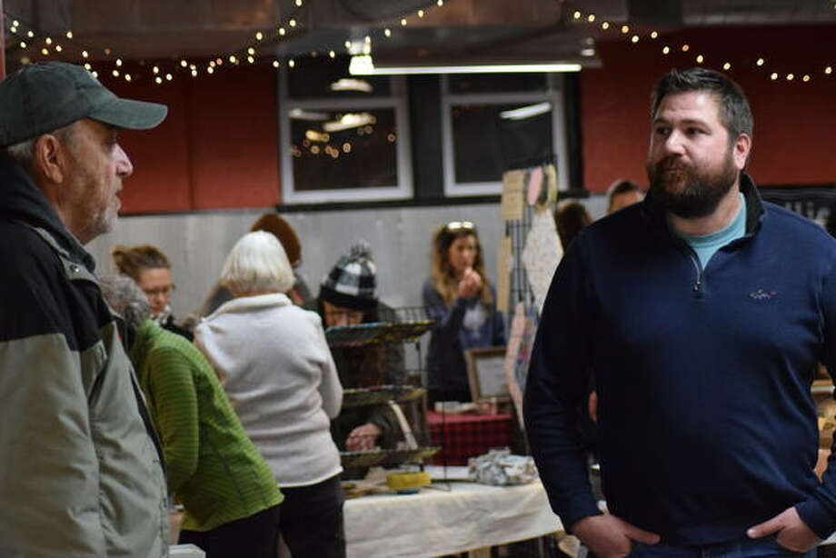 Vendors and patrons gather at Goshen Winter Market in the basement of the Newsong Fellowship building last year. Photo: Tyler Pletsch | Intelligencer File Photo