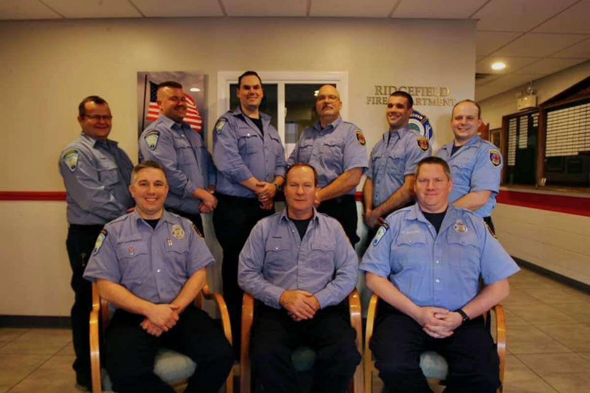 Firefighter Mike Drake, front row, center, with colleagues from the Ridgefield Fire Department shift he retired from. Drake is flanked by Rommie Duckworth, left and Lt. Patrick Holland. Behidn them are, from left: Ken Brown, Kevin Woessner, Ryan Underwood, Mike Gesmondi, Ed Marchitto and Matt Behuniak.