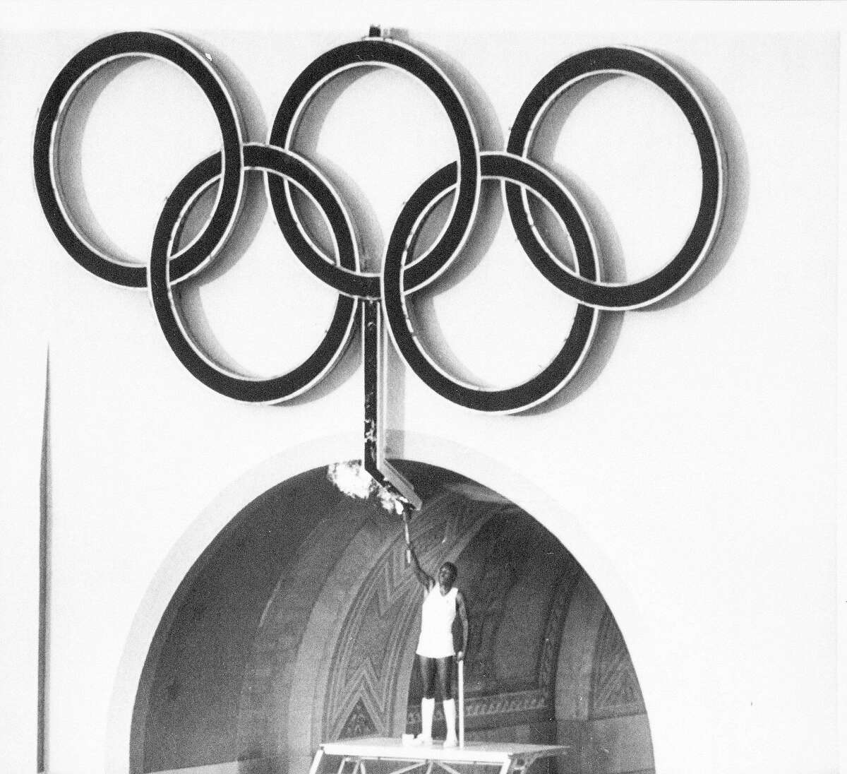 In this July 28, 1984, file photo, Rafer Johnson, winner of the gold medal for the decathlon in 1960, lights the Olympic torch during opening ceremonies of the Olympic Games in Los Angeles.