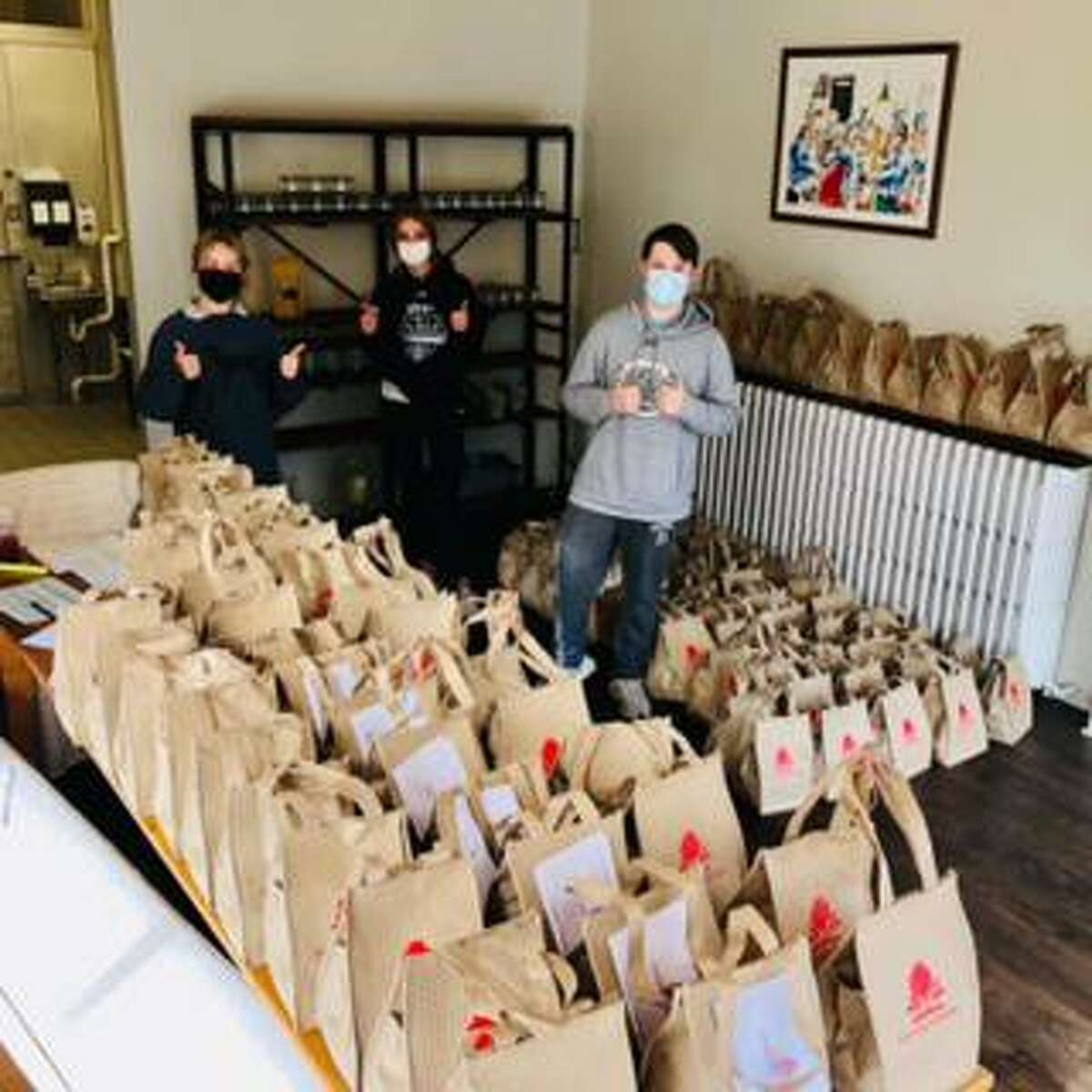 Courtnay Arpano, owner of Courtnay's Kitchen in town, helped make sure local seniors got a Thanksgiving meal courtesy of her restaurant by working with the Greenwich Commission on Aging and Greenwich Senior Center. Volunteers, like the ones pictured above, headed out all over town to safely deliver the meals.