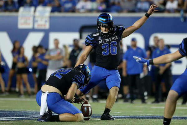 Memphis kicker Riley Patterson attempts a field goal during a game last season against Navy. An EHS grad, Patterson is in his his senior season.