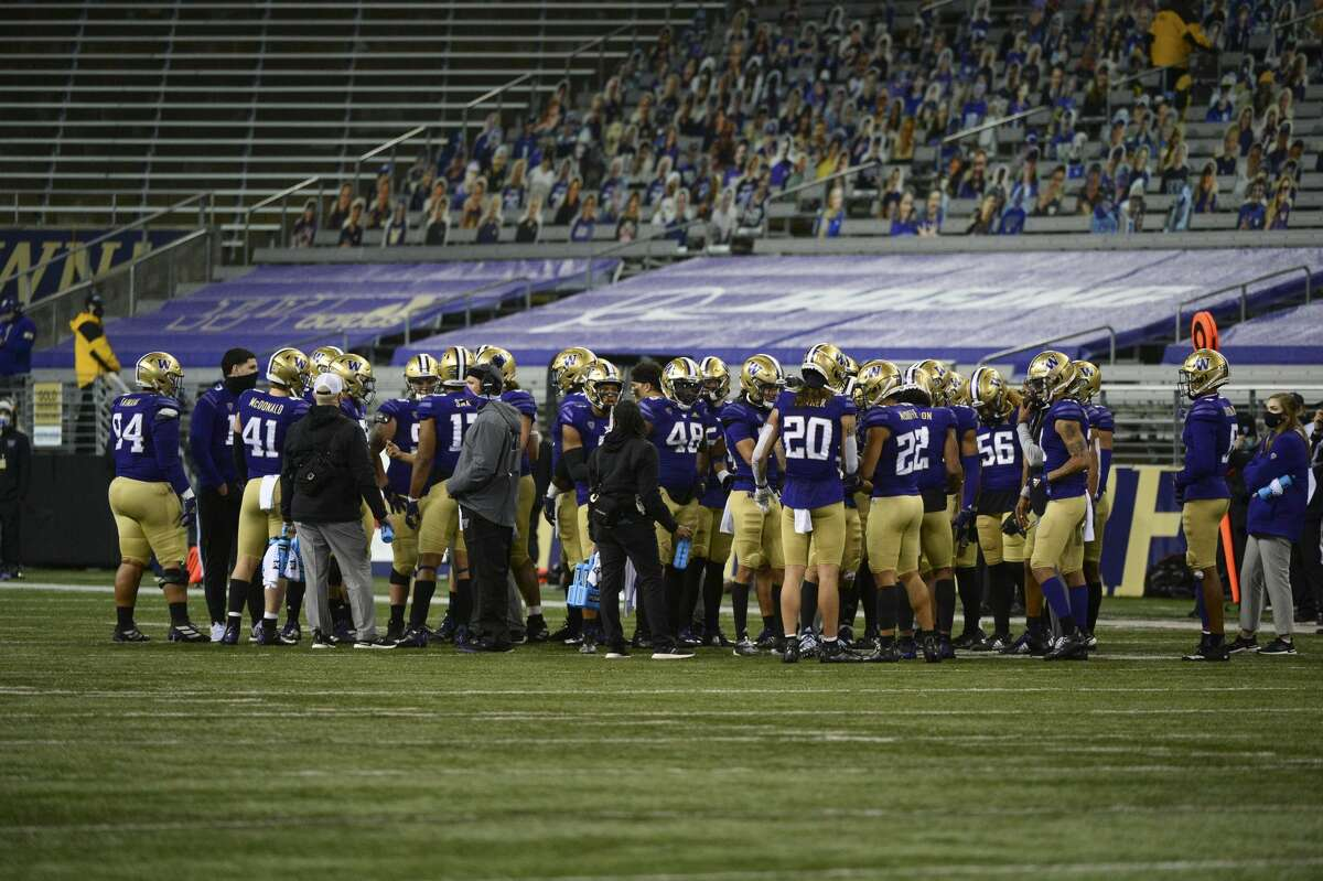 SEATTLE, WA - NOVEMBER 28: The Washington Huskies team meets during a time out in a PAC12 football game between the Utah Utes and the Washington Huskies on November 28, 2020, at Husky Stadium in Seattle, WA. (Photo by Jeff Halstead/Icon Sportswire via Getty Images)