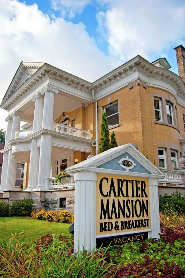 Jenna and Chris Simpler are the new owners of the historic Cartier Mansion in Ludington. (Courtesy photo)