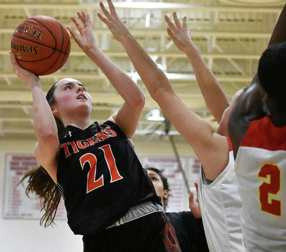 Edwardsville forward Elle Evans rises over two defenders for a basket in the first half against Incarnate Word last season in the championship game of the Visitation Christmas Tournament. Photo: Matt Kamp|The Intelligencer
