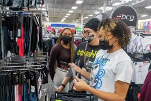 Mallory DeRouen, from right, Reye' Carrier, and Morgan DeRouen get an early start on their Christmas shopping. Shoppers were out taking advantage of the early Black Friday deals Wednesday at Academy Sports + Outdoors in Beaumont. Photo made on November 25, 2020. Fran Ruchalski/The Enterprise