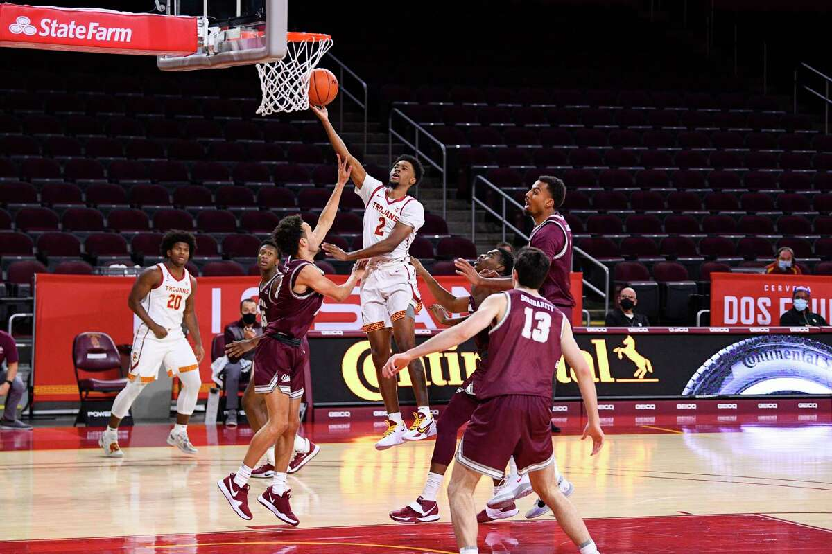 LOS ANGELES, CA - NOVEMBER 28: USC Trojans guard Tahj Eaddy (2) goes up for a shot during the college basketball game between the Montana Grizzlies and the USC Trojans on November 28, 2020 at Galen Center in Los Angeles, CA, during the COVID-19 Pandemic. (Photo by Brian Rothmuller/Icon Sportswire via Getty Images)