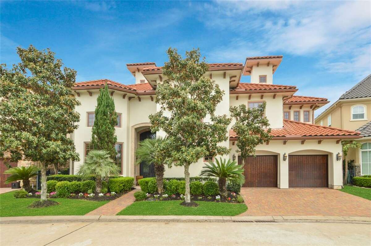 The home at 15402 Oyster Creek Lane in Sugar Land is under foreclosure. The property has been on the market since 2019 and recently saw a price reduction of 14 percent. Built in 2007, the three-bedroom residence is zoned to Fort Bend Schools. The 7,267-square-foot lot also features a swimming pool and waterfront green space.