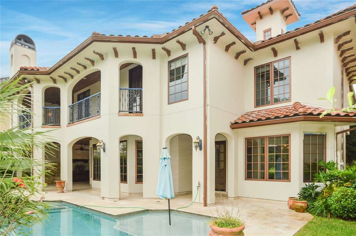 Outside, a large swimming pool overlooks the neighborhood lake. The smartly-equipped summer kitchen is as stylish as it is practical, with stone walls, outdoor fireplace and hooded vent. The property is on the lake and has a second-floor balcony that overlooks the grounds.