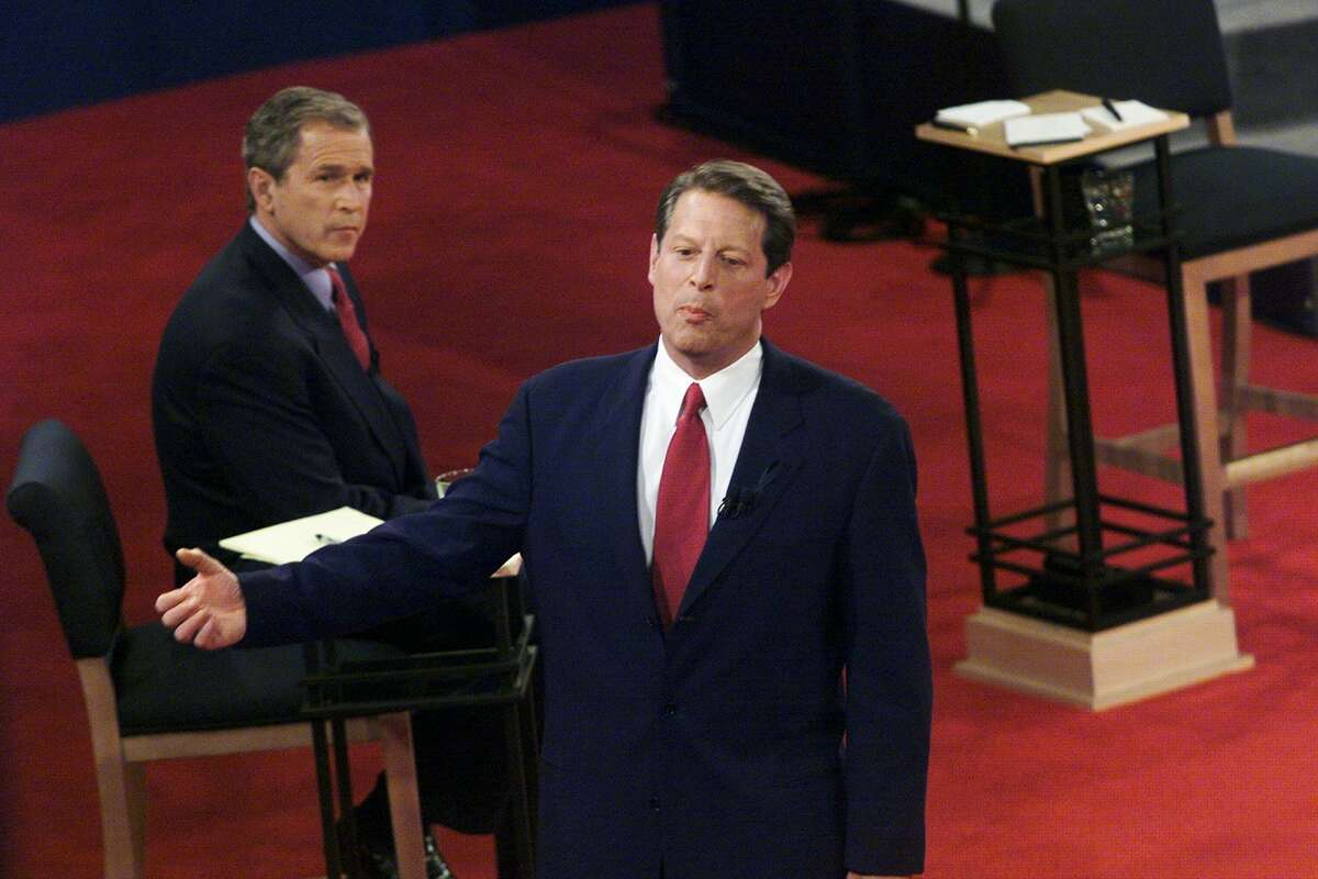 Texas Gov. George W. Bush looks on as Vice President Al Gore responds to a question in the third and final presidential debate at Washington University in St. Louis in 2000.