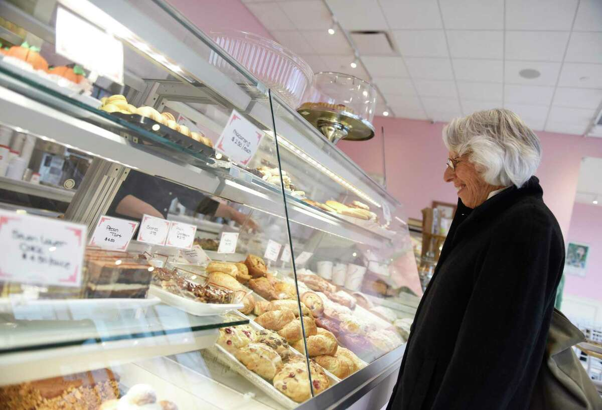 A customer orders in November 2018 at Patisserie Salzburg, among nearly 3,000 small businesses in Stamford to secure funding via the federal Paycheck Protection Program to lead the state.