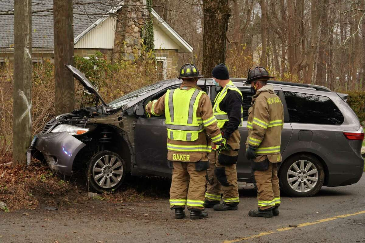 Several vehicles including an ambulance, New Canaan Fire Department trucks and New Canaan Police vehicles were near the corner of Ponus Ridge and Frogtown Road in New Canaan after an accident Wednesday, Dec. 2, around 2 p.m.
